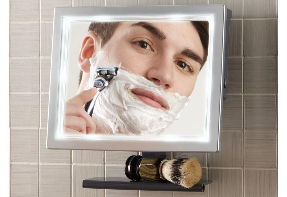pivoting fog free led shower mirror sharper image. Black Bedroom Furniture Sets. Home Design Ideas
