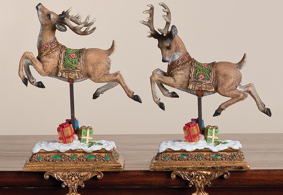 reindeer stocking holders set of 2 sharper image. Black Bedroom Furniture Sets. Home Design Ideas